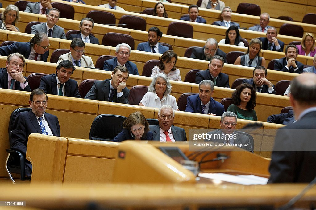 Spanish Prime Minister Mariano Rajoy listens to Socialist Party leader Alfredo Perez Rubalcaba during a parliament session over allegations on...