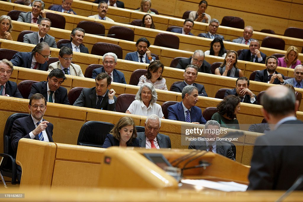 Spanish Prime Minister Mariano Rajoy (L) listens to Socialist Party (PSOE) leader <a gi-track='captionPersonalityLinkClicked' href=/galleries/search?phrase=Alfredo+Perez+Rubalcaba&family=editorial&specificpeople=692536 ng-click='$event.stopPropagation()'>Alfredo Perez Rubalcaba</a> (R) during a parliament session over allegations on corruption scandals addressed by Spanish Prime Minister Mariano Rajoy on August 1, 2013 in Madrid, Spain. Rajoy admitted he made a mistake in trusting his former party treasurer Luis Barcenas but denied doing anything wrong himself.
