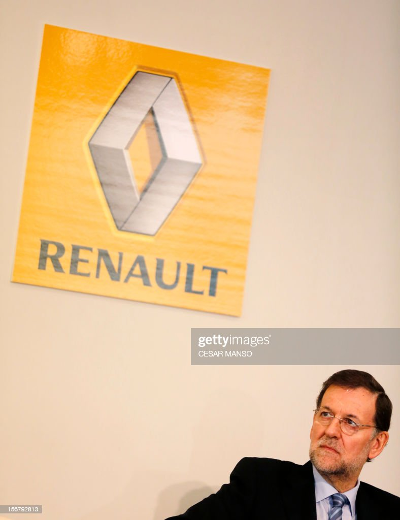 Spanish Prime Minister Mariano Rajoy listens to the President of Renault Spain Jose Vicente de los Mozos during a visit at the Villamuriel Renault factory in northern Spain on November 21, 2012. French car maker Renault plans to create 1,300 jobs at its factories in recession-hit Spain, Spanish Prime Minister Mariano Rajoy said. Renault has an industrial plan to develop its Spanish plants which will involve 'the creation of 1,300 new jobs', Rajoy said.