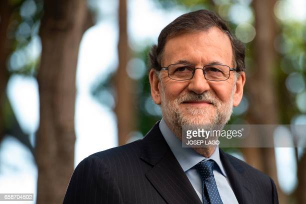 Spanish Prime Minister Mariano Rajoy looks on before a conference on infrastructure under the slogan 'Connected to the future' in Barcelona on March...