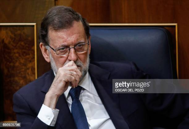 Spanish Prime Minister Mariano Rajoy looks on during a debate at the Congress of Deputies in Madrid on June 14 2017 before a vote of no confidence...