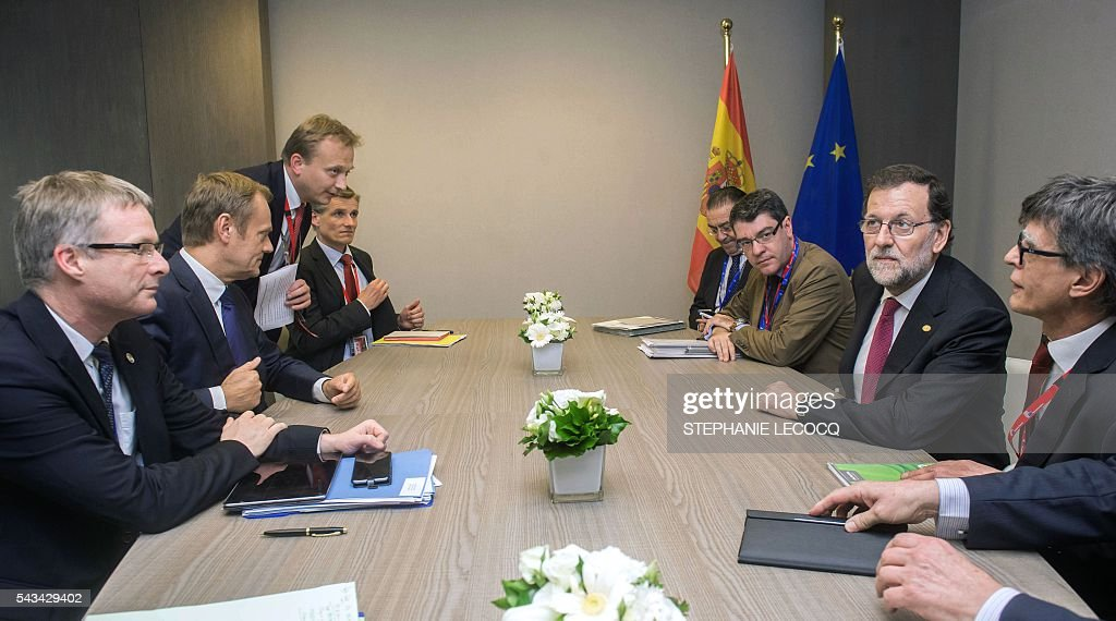 Spanish Prime Minister Mariano Rajoy (2nd R) meets European Union Council President Donald Tusk (2nd L)ahead of an European Union summit on June 28, 2016 at the EU headquarters in Brussels. Britain's exit from the European Union may erode the bloc's leadership role in fighting climate change and stymie crucial efforts to set more ambitious targets for cutting greenhouse gases, officials and experts said on June 28. European leaders meeting in Brussels pressured British Prime Minister David Cameron Tuesday to launch the two-year withdrawal process 'as soon as possible', but the embattled premier has vowed he will leave that task to a successor to be named on September 9. / AFP / POOL / STEPHANIE