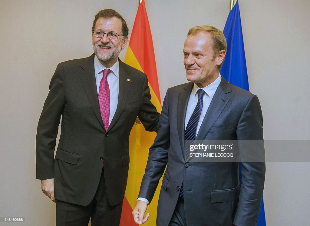 Spanish Prime Minister Mariano Rajoy (L) poses with European Union Council President Donald Tusk ahead of an European Union summit on June 28, 2016 at the EU headquarters in Brussels. Britain's exit from the European Union may erode the bloc's leadership role in fighting climate change and stymie crucial efforts to set more ambitious targets for cutting greenhouse gases, officials and experts said on June 28. European leaders meeting in Brussels pressured British Prime Minister David Cameron Tuesday to launch the two-year withdrawal process 'as soon as possible', but the embattled premier has vowed he will leave that task to a successor to be named on September 9. / AFP / POOL / STEPHANIE
