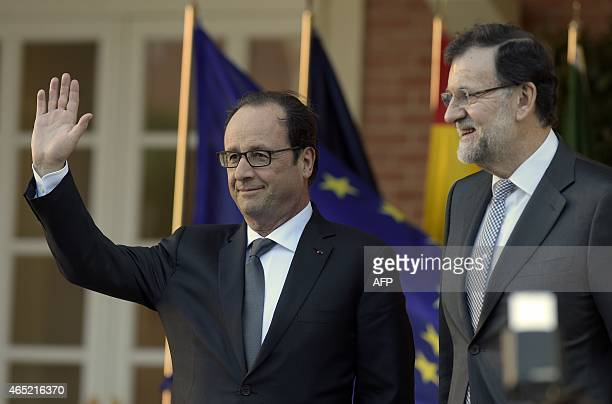 Spanish Prime Minister Mariano Rajoy poses with French President Francois Hollande before the Summit on the Interconnections to discuss funding for...