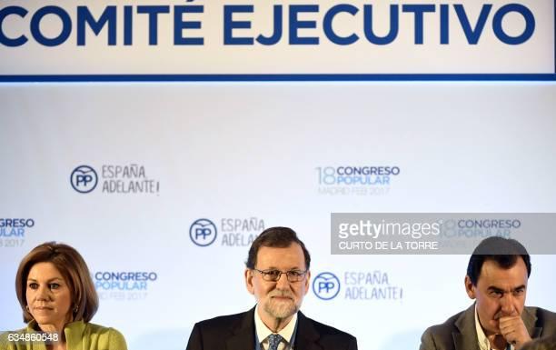 Spanish Prime Minister Mariano Rajoy PP Secretary General and Spanish Defense minister Maria Dolores de Cospedal and Fernando Martinez Maillo attend...