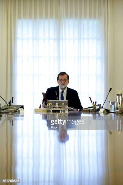 Spanish Prime Minister Mariano Rajoy presides over an extraordinary meeting of the Council of Ministers at Moncloa Palace on October 21 2017 in...