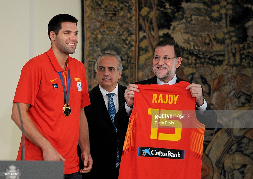 Spanish Prime Minister Mariano Rajoy reacts after being presented with a Spain jersey by captain Felipe Reyes at the Moncloa palace after Spain won the EuroBasket 2015 final on September 21, 2015 in Madrid, Spain. Spain beat Lithuania 80-63 in the final in Lille, France.