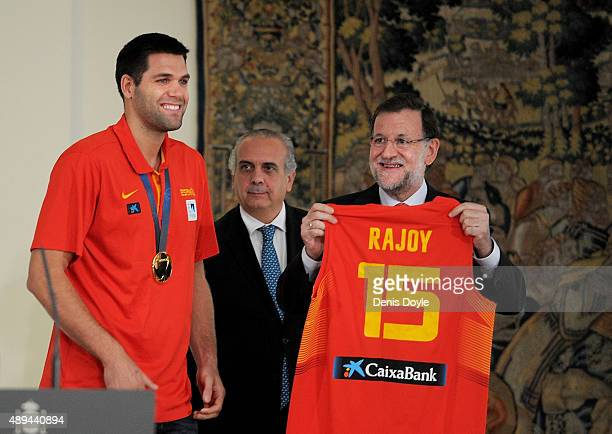 Spanish Prime Minister Mariano Rajoy reacts after being presented with a Spain jersey by captain Felipe Reyes at the Moncloa palace after Spain won...