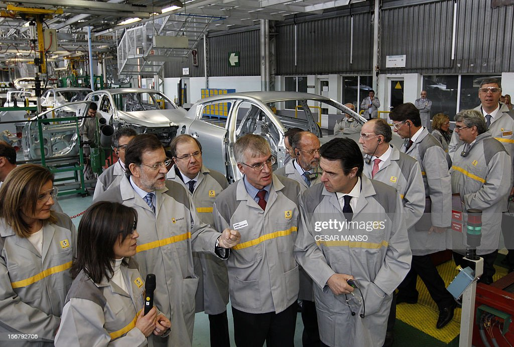 Spanish Prime Minister Mariano Rajoy (C), Spain's Minister of Employment and Social security Maria Fatima Banez Garcia (L) and Spain's Minister of Industry, Energy and Tourism Jose Manuel Soria (R) visit the Villamuriel Renault factory in northern Spain on November 21, 2012. French car maker Renault plans to create 1,300 jobs at its factories in recession-hit Spain, Spanish Prime Minister Mariano Rajoy said. Renault has an industrial plan to develop its Spanish plants which will involve 'the creation of 1,300 new jobs', Rajoy said.
