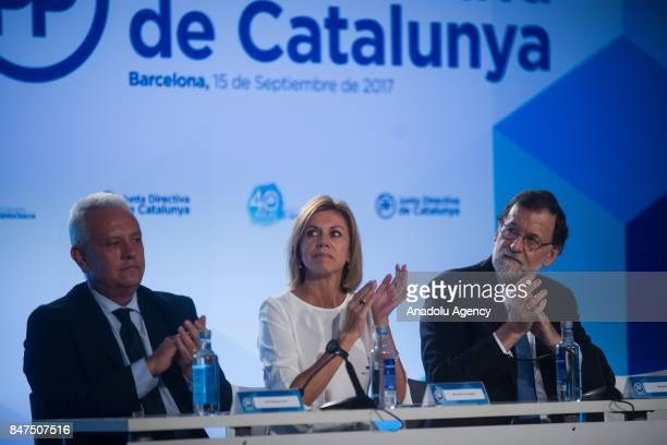 Spanish Prime Minister Mariano Rajoy Spanish Minister of Defence Maria Dolores de Cospedal and Santi Rodriguez of Partido Popular attend a regional...