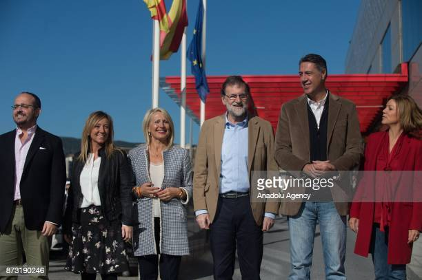 Spanish Prime Minister Mariano Rajoy Spanish Minister of Defence Maria Dolores de Cospedal and Leader of the Catalan Popular Party Xavier Garcia...
