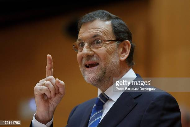 Spanish Prime Minister Mariano Rajoy speaks during the parliament session over allegations on corruption scandals on August 1 2013 in Madrid Spain...