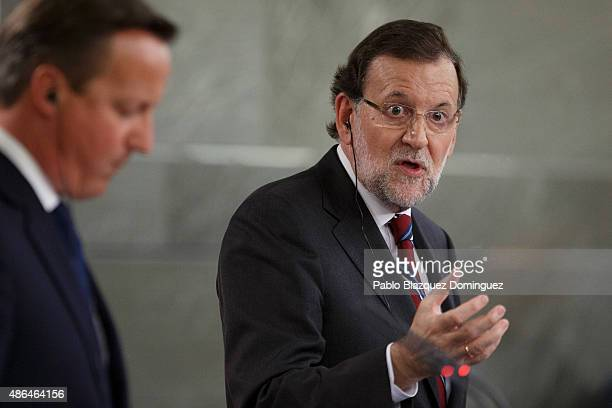 Spanish Prime Minister Mariano Rajoy speaks next to British Prime Minister David Cameron during a press conference at Moncloa Palace on September 4...