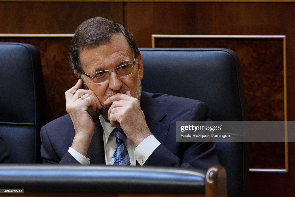 Spanish Prime Minister Mariano Rajoy speaks on the phone during a debate about a new law that would allow the abdication of King Juan Carlos of Spain on June 11, 2014 in Madrid, Spain. Since King Juan Carlos of Spain announced his decision to abdicate on June 2, multiple demonstrations have taken place within the country and even abroad calling for a referendum to decide whether the country should be a Monarchy or Republic. Today Spain's Parliament will debate and vote on a new law that would allow the abdication of King Juan Carlos of Spain and the coronation of his 46-year-old son Prince Felipe of Spain.