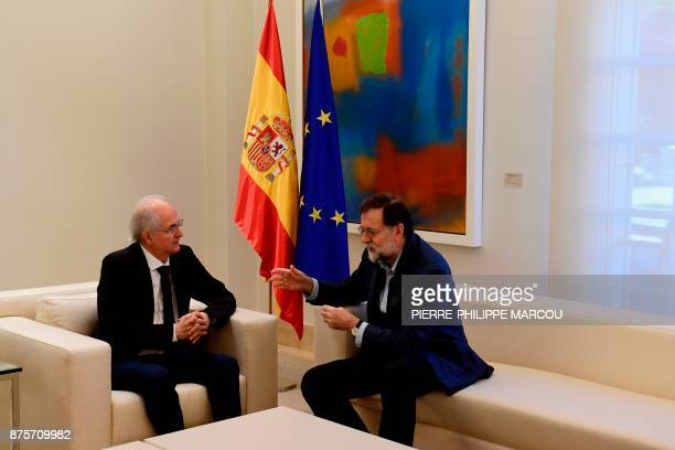 Spanish Prime Minister Mariano Rajoy speaks to former Caracas mayor Antonio Ledezma during a meeting in Madrid on November 18 2017 Ledezma arrived...