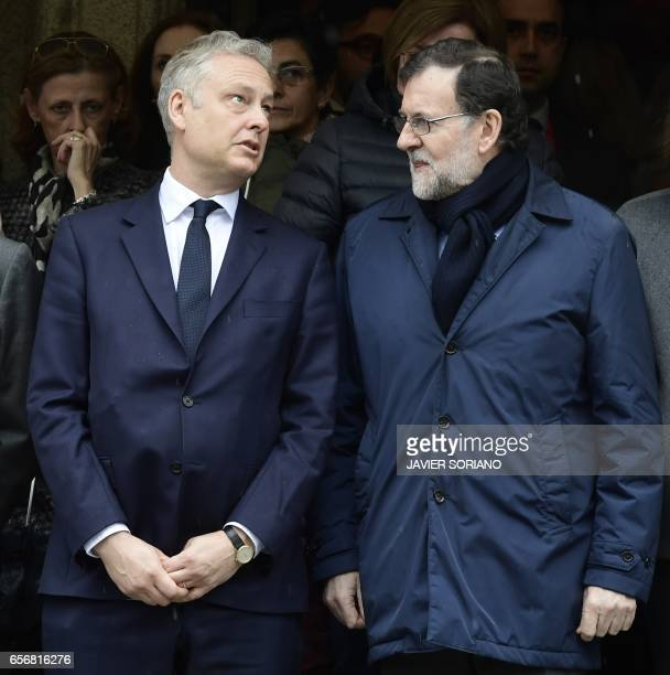 Spanish Prime Minister Mariano Rajoy speaks with British ambassador to Spain Simon Manley at La Moncloa Palace in Madrid prior to observing a minute...