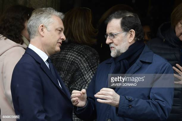 Spanish Prime Minister Mariano Rajoy speaks with British ambassador to Spain Simon Manley at La Moncloa Palace in Madrid after observing a minute of...