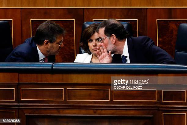 Spanish Prime Minister Mariano Rajoy speaks with Spanish vicePresident of the Government and Minister of the Presidency and of the Regional...