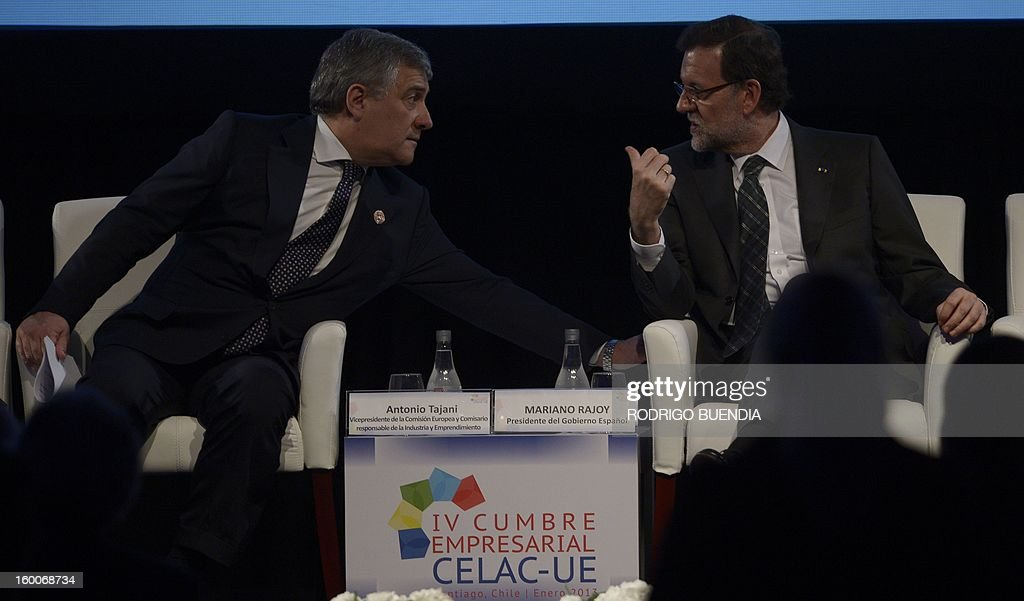 Spanish Prime Minister Mariano Rajoy (R) speaks with the vice-president of the European Commission, responsible for Industry and Entrepreneurship, Antonio Tajani, during the opening of the IV Business Meeting in the framework of the weekend's two-day CELAC-EU Summit in Santiago, during his official visit to Chile on January 25, 2013. More than 40 Heads of State and Government of the Community of Latin American and Caribbean States (CELAC) and the European Union (EU) will meet on January 26 and 27 to promote a strategic partnership between the two regions.