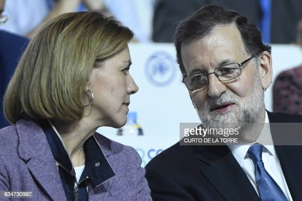 Spanish Prime Minister Mariano Rajoy talks with Spanish Defense Minister Maria Dolores De Cospedal during the XVIII Popular Party three day congress...