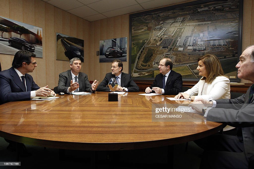 Spanish Prime Minister Mariano Rajoy (C), the President of Renault Spain Jose Vicente de los Mozos (2L), Spain's Minister of Industry, Energy and Tourism Jose Manuel Soria (L), Spain's Minister of Employment and Social security Maria Fatima Banez Garcia (2R) and Castilla y Leon Economy Minister Tomas Villanueva (R) meet at the Villamuriel Renault factory in northern Spain on November 21, 2012. French car maker Renault plans to create 1,300 jobs at its factories in recession-hit Spain, Spanish Prime Minister Mariano Rajoy said. Renault has an industrial plan to develop its Spanish plants which will involve 'the creation of 1,300 new jobs', Rajoy said.