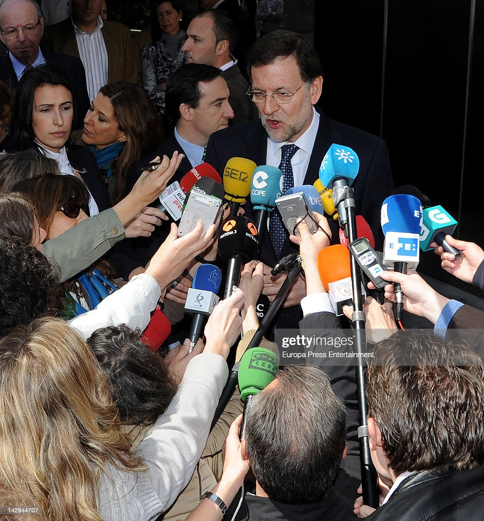 Spanish Prime Minister Mariano Rajoy visits King Juan Carlos of Spain at USP San Jose Hospital on April 15, 2012 in Madrid, Spain. King Juan Carlos of Spain underwent an operation on his right hip after he fractured it in a fall during a private visit to Botswana.