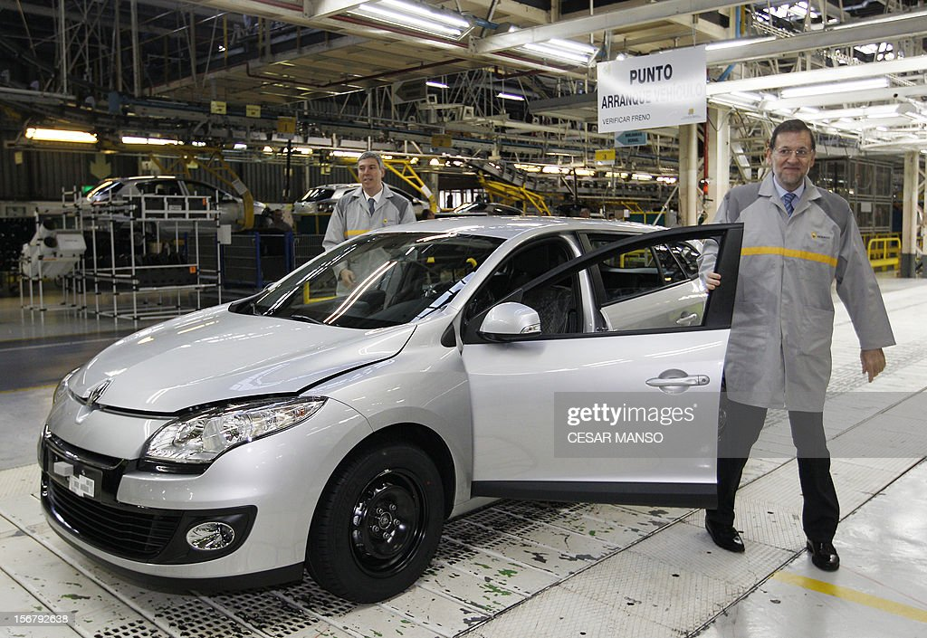 Spanish Prime Minister Mariano Rajoy (R) visits the Villamuriel Renault factory in northern Spain on November 21, 2012. French car maker Renault plans to create 1,300 jobs at its factories in recession-hit Spain, Spanish Prime Minister Mariano Rajoy said. Renault has an industrial plan to develop its Spanish plants which will involve 'the creation of 1,300 new jobs', Rajoy said.