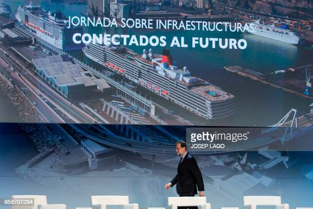 Spanish Prime Minister Mariano Rajoy walks to make the opening speech during a conference on infrastructure under the slogan 'Connected to the...