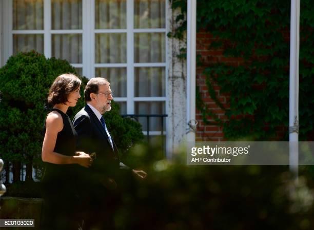 Spanish Prime Minister Mariano Rajoy walks with SpanishVenezuelan tennis player Garbine Muguruza at La Moncloa palace in Madrid on July 21 2017 The...