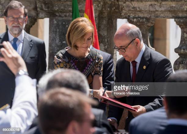Spanish Prime Minister Mariano Rajoy watches over as Spanish Defense Minister Maria Dolores de Cospedal and Portuguese Defence Minister Jose Alberto...