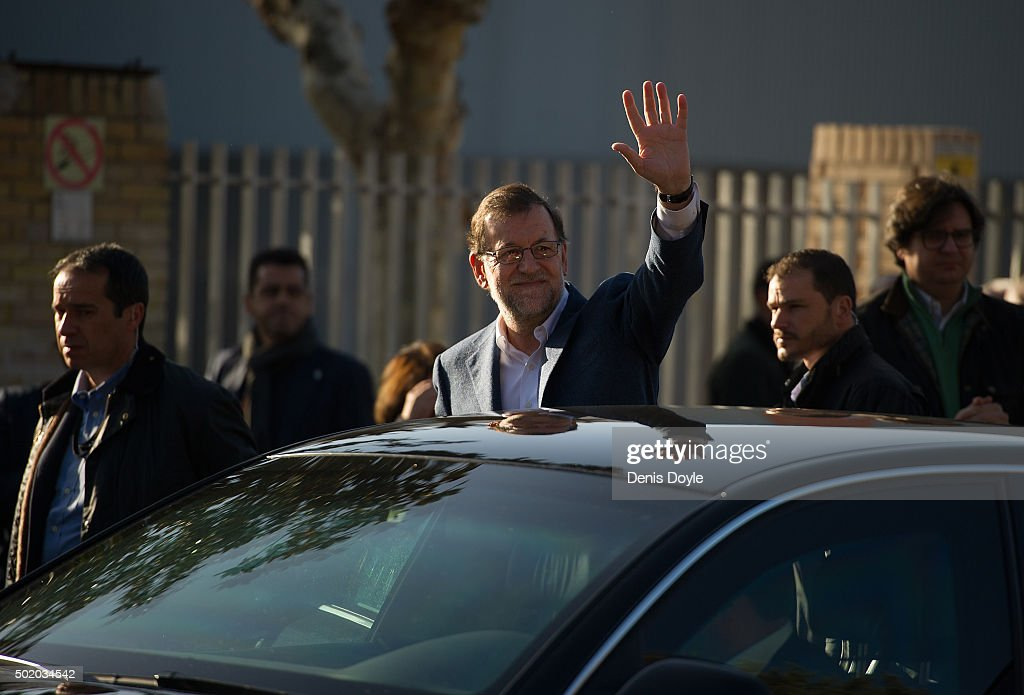 Spanish Prime Minister Mariano Rajoy waves after casting his vote at a polling station during General Elections on December 20 2015 in Madrid Spain...
