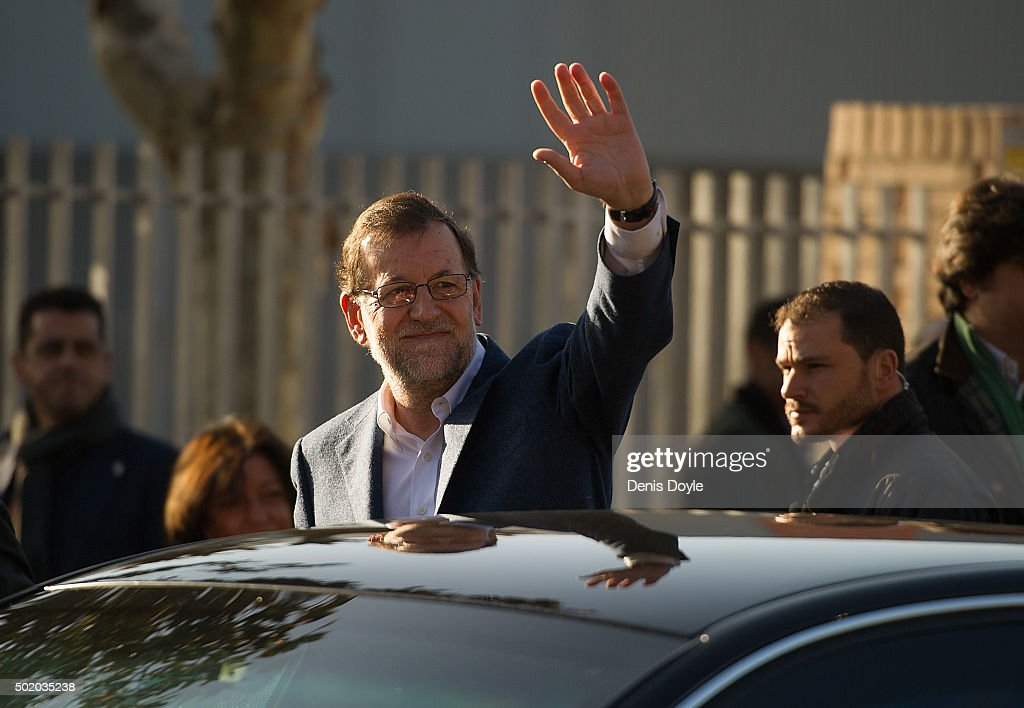 Spanish Prime Minister Mariano Rajoy waves after casting his vote at a polling station during General Elections on December 20, 2015 in Madrid, Spain. Spaniards went to the polls today to vote for 350 members of the parliament and 208 senators. For the first time since 1982, the two traditional Spanish political parties, right-wing Partido Popular (People's Party) and centre-left wing Partido Socialista Obrero Espanol PSOE (Spanish Socialist Workers' Party), held a tight election race with two new contenders, Ciudadanos (Citizens) and Podemos (We Can) attracting right-leaning and left-leaning voters respectively.