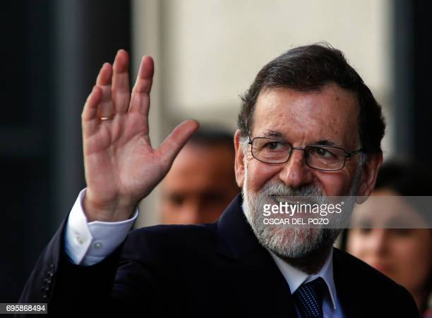 Spanish Prime Minister Mariano Rajoy waves as he arrives at the Congress of Deputies in Madrid on June 14 2017 before a vote of no confidence tabled...