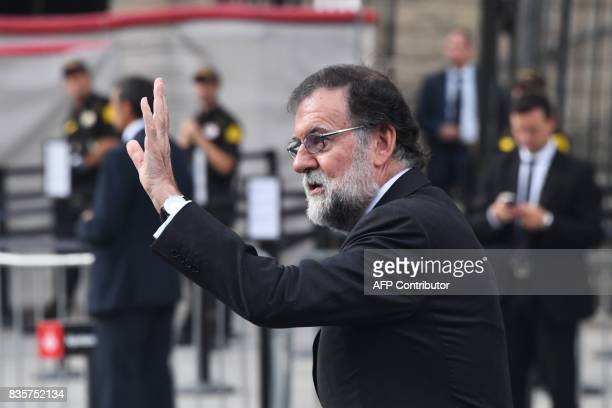 Spanish Prime Minister Mariano Rajoy waves as he arrives for a mass to commemorate victims of two devastating terror attacks in Barcelona and...