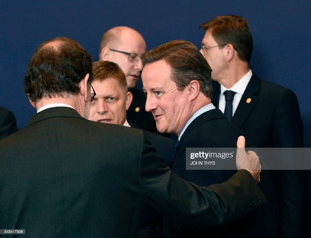 Spanish Prime minister talks with Britain Prime minister David Cameron (R) during EU - Summit at the EU headquarters in Brussels on June 28, 2016. Prime Minister David Cameron said Tuesday he wants the 'closest possible' relations with the EU after Britain voted to leave the bloc, adding the split should be 'as constructive as possible'. As he arrived at a Brussels summit, Cameron, who is to step down within weeks, told reporters that, while Britain was leaving the EU, 'we mustn't be turning our backs on Europe.' THYS