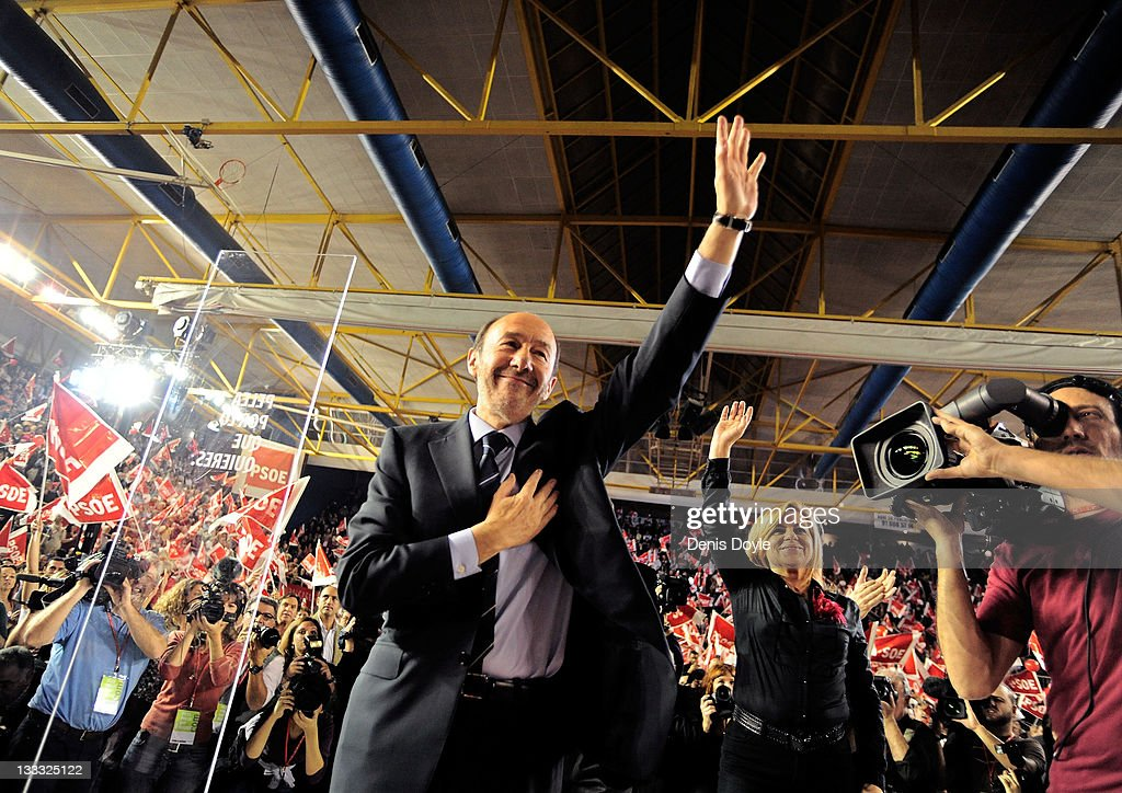 Spanish prime ministerial candidate Alfredo Perez Rubalcaba of the Socialist party waves to supporters during his party's campaign closing meeting...