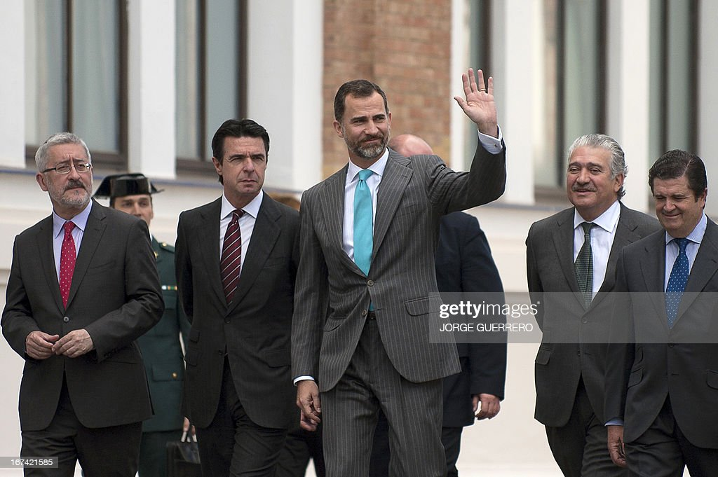 Spanish Prince Felipe (C) walks next to Spain's Minister for Industry, Energy and Tourism Jose Manuel Soria (2nd L) after inaugurating the project 'Zem2All' at the Automobile museum in Malaga on April 25, 2013. Zem2All is a pilot project, carried out alongside the Japanese government, designed to estimate usage by drivers of electric vehicles in Malaga and provide an in-depth study of the impact of these vehicles. The city installed 229 recharging points and delivered 200 e-vehicles to participants in the project.