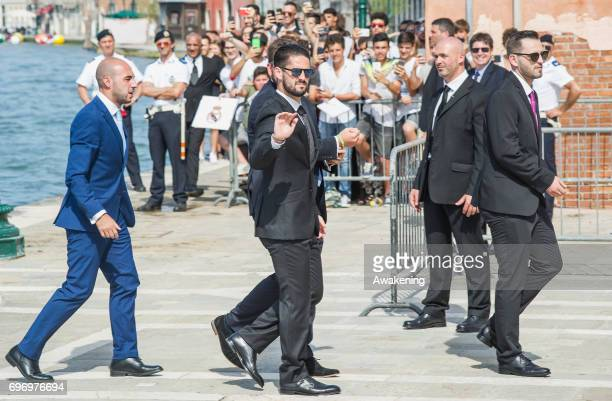 Spanish professional footballer Isco arrives to the wedding of Spanish professional footballer Alvaro Morata and Italian model Alice Campello at the...