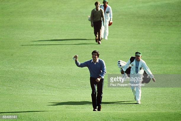 Seve Ballesteros of Spain acknowledges the crowd on the 18th hole during the final round of the US Masters played at the Augusta National Golf Club...