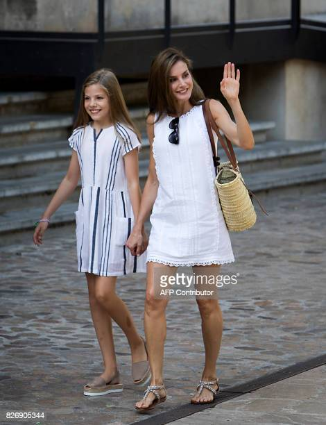 Spanish Queen Letizia and her daughter Spanish crown princess Sofia walk down a street in the village of Soller on Mallorca island on August 6 2017 /...
