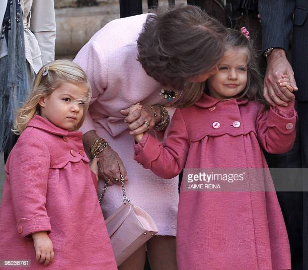 Spanish Queen Sofia kisses her grandaugther Leonor flanked with her sister Sofia as they pose for a family picture after the traditional Easter Mass...