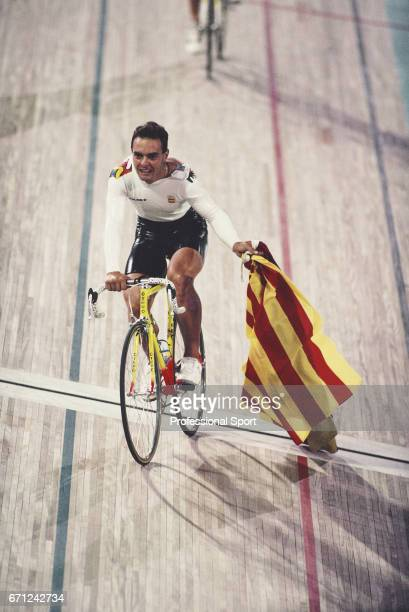 Spanish racing cyclist Jose Manuel Moreno pictured holding the Spanish national flag whilst cycling after competition to finish in first place to win...