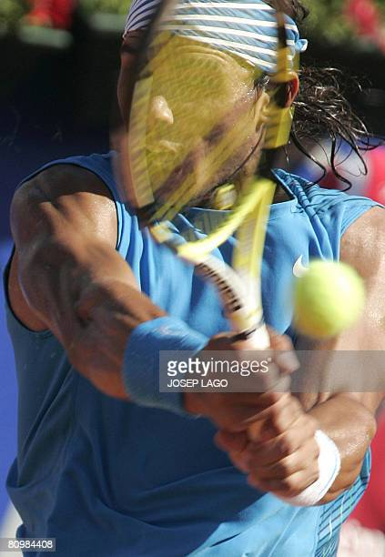 Spanish Rafael Nadal returns the ball to his Spanish opponent David Ferrer during the final match of the Barcelona Open tennis tournament Conde de...