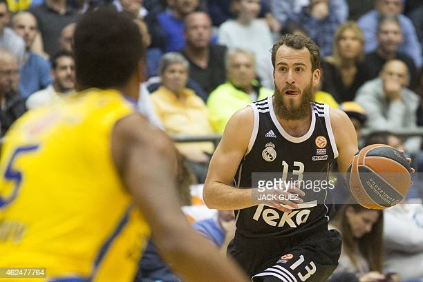 Spanish Real Madrid's Spanish guard Sergio Rodriguez dribbles the ball as Israel Maccabi Electra Tel Aviv's US guard Marquez Haynes defends during...