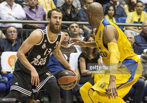 Spanish Real Madrid's Spanish guard Sergio Rodriguez dribbles the ball as Israel Maccabi Electra Tel Aviv's Israeli forward Alex Tyus defends during...