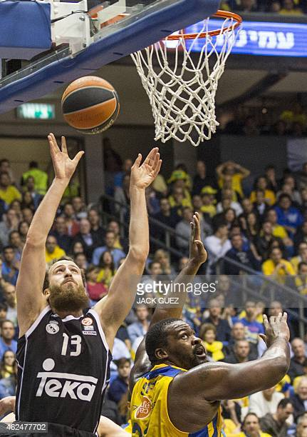 Spanish Real Madrid's Spanish guard Sergio Rodriguez jumps for the ball against Israel Maccabi Electra Tel Aviv's Greek center Sofoklis Schortsanitis...