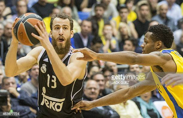 Spanish Real Madrid's Spanish guard Sergio Rodriguez vies for the ball against Israel Maccabi Electra Tel Aviv's US guard Jeremy Pargo during their...