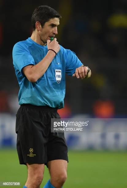 Spanish referee Alberto Undiano Mallenco reacts during the second leg UEFA Champions League Group D football match BVB Borussia Dortmund vs...