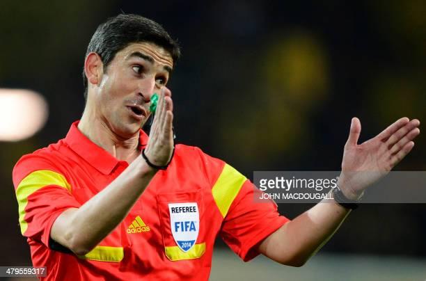 Spanish referee Undiano Mallenco gestures during the last 16 secondleg UEFA Champions League football match Borussia Dortmund vs Zenit St Petersburg...