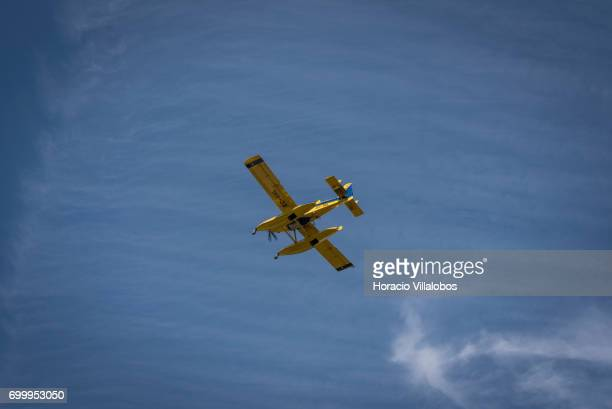 Spanish registered Air TractorÕs AT802F ÒFire BossÓ flies on June 22 2017 over Pedrogao Grande Portugal This is one of several aircraft used to fight...